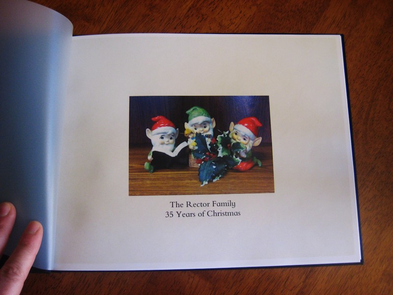 Inside front cover. This shows through on the front. My porcelain Christmas elves.